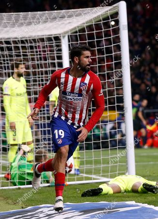 Xavi Hernandez. Atletico's Diego Costa celebrates after scoring the opening goal during a Spanish La Liga soccer match between Atletico Madrid and FC Barcelona at the Metropolitano stadium in Madrid