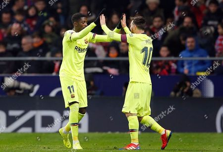 Xavi Hernandez. Barcelona's Ousmane Dembele, left, celebrates with Lionel Messi after scoring his side's first goal during a Spanish La Liga soccer match between Atletico Madrid and FC Barcelona at the Metropolitano stadium in Madrid