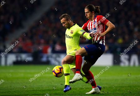 Xavi Hernandez. Atletico's Filipe Luis fights for the ball with Barcelona's Arthur, left, during a Spanish La Liga soccer match between Atletico Madrid and FC Barcelona at the Metropolitano stadium in Madrid