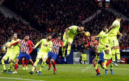 Xavi Hernandez. Barcelona's Arturo Vidal center jumps for the ball leaving his arm in the way during a Spanish La Liga soccer match between Atletico Madrid and FC Barcelona at the Metropolitano stadium in Madrid