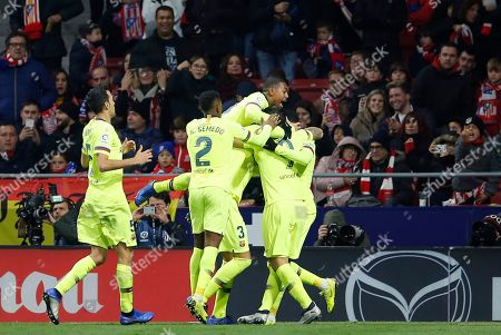 Xavi Hernandez. Barcelona players celebrate after Ousmane Dembele scored their first goal during a Spanish La Liga soccer match between Atletico Madrid and FC Barcelona at the Metropolitano stadium in Madrid