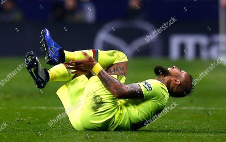 Xavi Hernandez. Barcelona's Arturo Vidal falls down on the pitch during a Spanish La Liga soccer match between Atletico Madrid and FC Barcelona at the Metropolitano stadium in Madrid