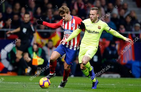 Xavi Hernandez. Atletico's Antoine Griezmann vies for the ball with Barcelona's Arthur, right, during a Spanish La Liga soccer match between Atletico Madrid and FC Barcelona at the Metropolitano stadium in Madrid