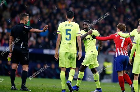 Xavi Hernandez. Barcelona's Samuel Umtiti, center, gestures to Referee Gil Manzano during a Spanish La Liga soccer match between Atletico Madrid and FC Barcelona at the Metropolitano stadium in Madrid