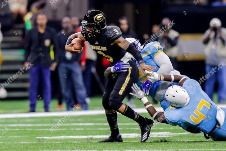 Grambling State Tigers quarterback Charles Wright (3) is tackled by Southern University Jaguars defensive tackle Dakavion Champion (91) during the game between the Grambling State Tigers and the Southern University Jaguars at Mercedes-Benz Superdome in New Orleans, LA