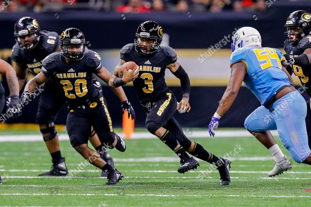 Southern University Jaguars defensive lineman Jaron Johnson (54) makes a tackle against Grambling State Tigers quarterback Charles Wright (3) during the game between the Grambling State Tigers and the Southern University Jaguars at Mercedes-Benz Superdome in New Orleans, LA