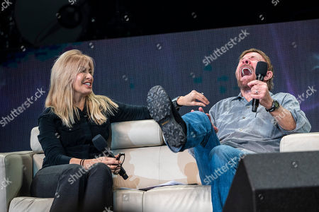 US actor and martial artist Chuck Norris, this year?s special guest and his wife, Gena O'Kelley talk onstage during the opening gala of the 15th Shoe Box fundraising event in Papp Laszlo Sports Arena in Budapest, Hungary, 24 November 2018. The annual Christmas charity campaign was launched by the Hungarian Baptist Aid (HBAid) in 2004 to collect and distribute gifts donated by the public for underprivileged children during Advent. The organisation receives the labelled and boxed presents at nearly 300 designated collection points in the country.