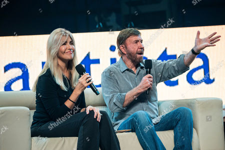 US actor and martial artist Chuck Norris, this year's special guest and his wife, Gena O'Kelley talk onstage during the opening gala of the 15th Shoe Box fundraising event in Papp Laszlo Sports Arena in Budapest, Hungary, 24 November 2018. The annual Christmas charity campaign was launched by the Hungarian Baptist Aid (HBAid) in 2004 to collect and distribute gifts donated by the public for underprivileged children during Advent. The organisation receives the labelled and boxed presents at nearly 300 designated collection points in the country.