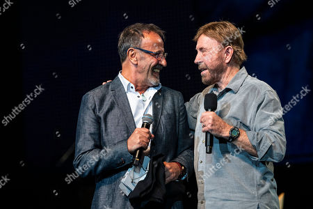 US actor and martial artist Chuck Norris (R), this year?s special guest and Hungarian actor and Norris' voice-over Csaba Jakab talk onstage during the opening gala of the 15th Shoe Box fundraising event in Papp Laszlo Sports Arena in Budapest, Hungary, 24 November 2018. The annual Christmas charity campaign was launched by the Hungarian Baptist Aid (HBAid) in 2004 to collect and distribute gifts donated by the public for underprivileged children during Advent. The organisation receives the labelled and boxed presents at nearly 300 designated collection points in the country.