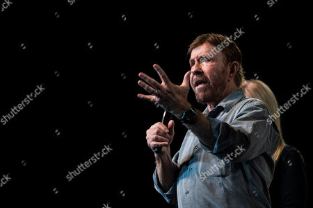 US actor and martial artist Chuck Norris, this year?s special guest talks onstage during the opening gala of the 15th Shoe Box fundraising event in Papp Laszlo Sports Arena in Budapest, Hungary, 24 November 2018. The annual Christmas charity campaign was launched by the Hungarian Baptist Aid (HBAid) in 2004 to collect and distribute gifts donated by the public for underprivileged children during Advent. The organisation receives the labelled and boxed presents at nearly 300 designated collection points in the country.