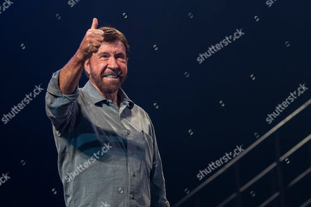 US actor and martial artist Chuck Norris, this year?s special guest gestures to the audience onstage during the opening gala of the 15th Shoe Box fundraising event in Papp Laszlo Sports Arena in Budapest, Hungary, 24 November 2018. The annual Christmas charity campaign was launched by the Hungarian Baptist Aid (HBAid) in 2004 to collect and distribute gifts donated by the public for underprivileged children during Advent. The organisation receives the labelled and boxed presents at nearly 300 designated collection points in the country.