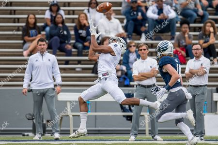 Old Dominion Monarchs wide receiver Travis Fulgham (7) makes a catch in front of Rice Owls cornerback Andrew Bird (19) during the 1st quarter of an NCAA football game between the Old Dominion Monarchs and the Rice Owls at Rice Stadium in Houston, TX. Rice won the game 27 to 13