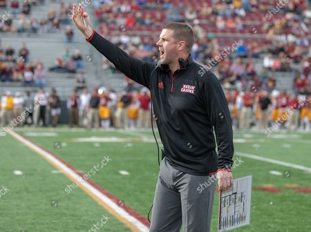 Stock Image of Louisiana head coach Billy Napier yells at the officials during the NCAA Football game between the Louisiana Ragin' Cajuns and the ULM Warhawks at Malone Stadium in Monroe, Louisiana