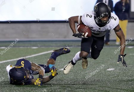 Stock Image of Ronnie Blackmon, Trey Turner III. Colorado's Ronnie Blackmon, right, runs past California's Trey Turner III while returning a kick during the second half of an NCAA college football game in Berkeley, Calif., . California won, 33-21