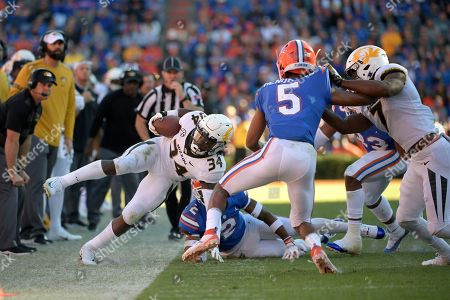 Missouri running back Larry Rountree III (34) is knocked out of bounds by Florida defensive back Brad Stewart Jr. (2) after rushing for yardage during the first half of an NCAA college football game, in Gainesville, Fla