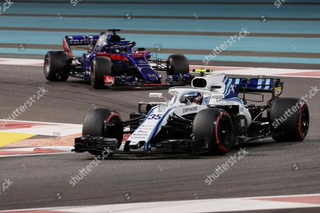 Stock Picture of Russian Formula One driver Sergey Sirotkin of Williams (front) and New Zealand's Formula One driver Brendon Hartley of Scuderia Toro Rosso (back) in action during the Abu Dhabi Formula One Grand Prix 2018 at Yas Marina Circuit in Abu Dhabi, United Arab Emirates, 25 November 2018.
