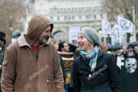 Extinction Rebellion campaigners Roger Hallam (Left) and Dr Gail Bradbroock (Right) seen at the front of the march.