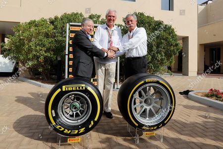Formula One CEO Chase Carey, right, Pirelli CEO Marco Tronchetti Provera, left and FIA President Jean Todd pose for a picture behind the new Pirelli tyre during a presentation ahead of the Emirates Formula One Grand Prix at the Yas Marina racetrack in Abu Dhabi, United Arab Emirates, . Formula One has reached a new four-year deal with Pirelli as it tire supplier from 2020-23 inclusive