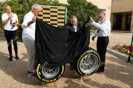 Formula One CEO Chase Carey, right, Pirelli CEO Marco Tronchetti Provera, left and FIA President Jean Todd unveil the new Pirelli tyre during a presentation ahead of the Emirates Formula One Grand Prix at the Yas Marina racetrack in Abu Dhabi, United Arab Emirates, . Formula One has reached a new four-year deal with Pirelli as it tire supplier from 2020-23 inclusive