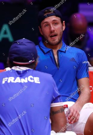 France's Lucas Pouille, right, talks to captain Yannick Noah as Pouille plays Croatia's Marin Cilic during the Davis Cup final between France and Croatia in Lille, northern France