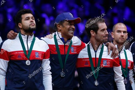 French team captain Yannick Noah, center, grimaces with players France's Jo-Wilfried Tsonga, left, and, France's Richard Gasquet after the Davis Cup final between France and Croatia in Lille, northern France. Marin Cilic sealed Croatia's victory over defending champion France in the Davis Cup final with a 7-6 (3), 6-3, 6-3
