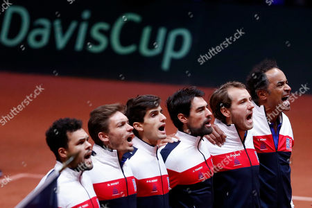 The French team, from the left, France's Jo-Wilfried Tsonga, Pierre Hughes Herbert, Nicolas Mahut, Jeremy Chardy, Lucas Pouille and team captain Yannick Noah sing the national anthem before the Davis Cup final between France and Croatia in Lille, northern France