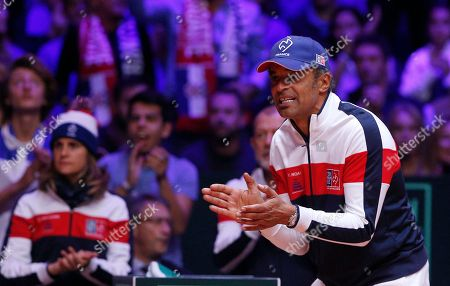 French team captain Yannick Noah applauds as Croatia's Marin Cilic plays France's Lucas Pouille during the Davis Cup final between France and Croatia in Lille, northern France