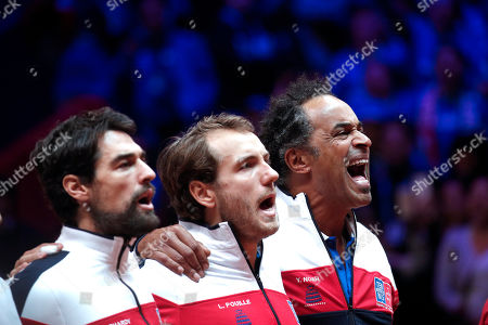French Davis Cup team captain Yannick Noah (R) sings the national anthem prior to the Davis Cup Final match between France and Croatia at the Pierre Mauroy Stadium in Villeneuve-d'Ascq, near Lille, France, 25 November 2018.