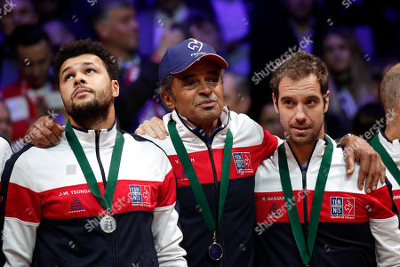 French Davis Cup team captain Yannick Noah (C), Jo-Wilfried Tsonga (L) and Richard Gasquet (R) react after France lost the Davis Cup Final between France and Croatia at the Pierre Mauroy Stadium in Villeneuve-d'Ascq, near Lille, France, 25 November 2018.