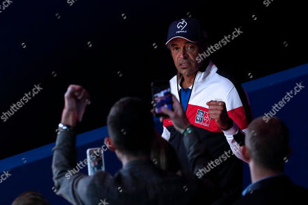 French Davis Cup team captain Yannick Noah (R) arrives prior to the Davis Cup Final match between France and Croatia at the Pierre Mauroy Stadium in Villeneuve-d'Ascq, near Lille, France, 25 November 2018.