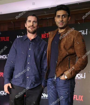 Abhishek Bachchan, Christian Bale. Actors Christian Bale, left, and Abhishek Bachchan pose after the trailer launch of Netflix's Mowgli in Mumbai, India