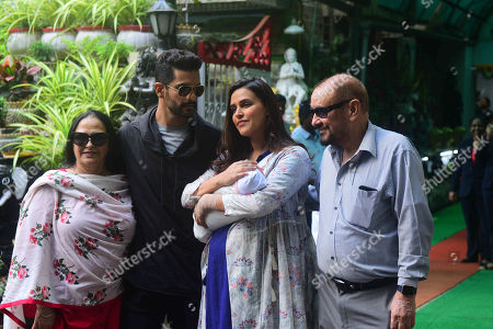 Bollywood actors Angad Bedi and Neha Dhupia with newborn baby Mehr and their parents after getting discharged from hospital