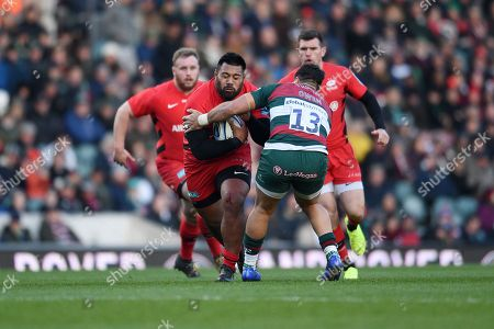 Christopher Tolofua of Saracens is challenged by Gareth Owen of Leicester Tigers.