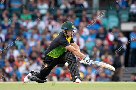 Australian player Aaron Finch (c) misses the ball at the International Gillette T20 cricket match between Australia and India at The Sydney Cricket Ground in NSW