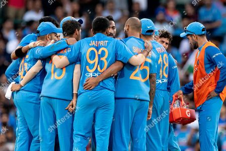 Indian team celebrate the wicket of Australian player Aaron Finch (c) at the International Gillette T20 cricket match between Australia and India at The Sydney Cricket Ground in NSW