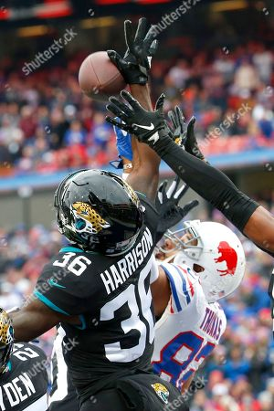 Jacksonville Jaguars defensive back Ronnie Harrison (36) and Buffalo Bills tight end Logan Thomas (82) go up for the ball on a pass into the end zone from quarterback Josh Allen, not pictured, during the first half of an NFL football game, in Orchard Park, N.Y