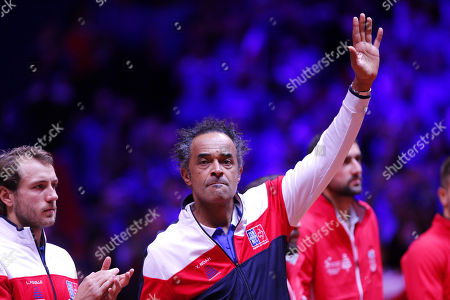 Yannick Noah, French Team Captain, waves to the crowd