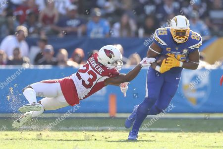 Bene' Benwikere; Antonio Gates. Arizona Cardinals cornerback Bene' Benwikere (23) fails to bring down Los Angeles Chargers tight end Antonio Gates (85) after a reception and run in the first half of an NFL football game, in Carson, Calif