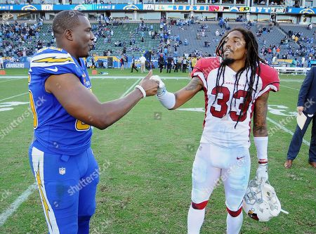Antonio Gates - Tre Boston. Los Angeles Chargers tight end Antonio Gates (85) on the field with Arizona Cardinals safety Tre Boston (33) after the Chargers defeated the Cardinals 45 to 10 in an NFL football game played on in Carson, Calif