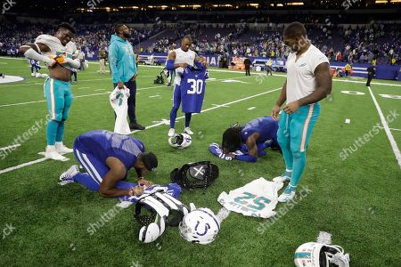 Players including Miami Dolphins middle linebacker Raekwon McMillan (52), Indianapolis Colts defensive back George Odum (30), defensive end Tyquan Lewis (94) and free safety Malik Hooker (29) exchange their jerseys following an NFL football game in Indianapolis, . The Colts defeated the Dolphins 27-24