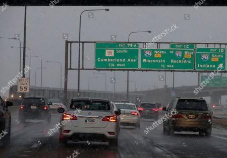 Heavy traffic is seen on an expressway near O'Hare airport in Chicago, . More than 700 flights canceled as blizzard warning takes effect in Chicago. A winter storm warning has been extended for Cook, DuPage, Grundy, Kendall, Lake and Will counties through 9 a.m. Monday, according to the National Weather Service