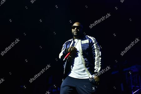 Rico Love performs on stage