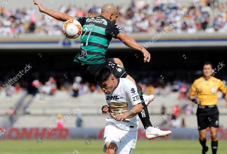 Pumas' Pablo Barrera (down) vies for the ball against Doria (up) of Santos Laguna, during the game of the 17th day of Mexican soccer, at the Olympic University Stadium in Mexico City, Mexico, 25 November 2018.