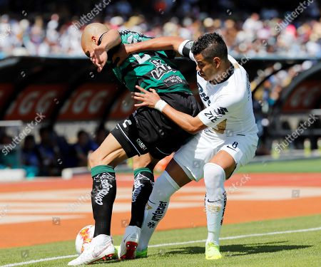 Pumas' Pablo Barrera (R) vies for the ball against Doria (L) of Santos Laguna, during the game of the 17th day of Mexican soccer, at the Olympic University Stadium in Mexico City, Mexico, 25 November 2018.