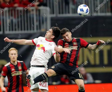 Eric Remedi, Brian White. Atlanta United midfielder Eric Remedi (11) and New York Red Bulls forward Brian White (42) head the ball In the second half of an MLS soccer playoff game, in Atlanta