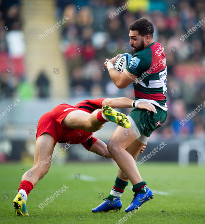 Gareth Owen of Leicester Tigers is tackled by Alex Lewington of Saracens