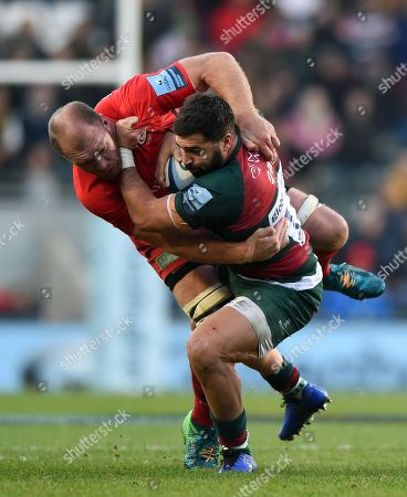 Gareth Owen of Leicester Tigers is tackled by Schalk Burger of Saracens