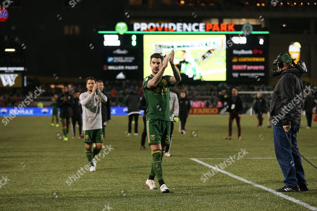 Portland Timbers defender Liam Ridgewell (24) thanks the Timbers Army after a game between Sporting KC and the Portland Timbers at Providence Park in Portland, OR. Sporting KC and the Timbers tied 0-0 in the first leg of the MLS Western Conference Finals
