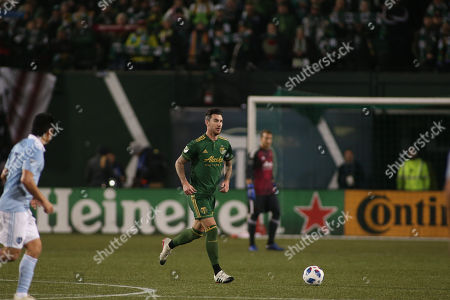 Portland Timbers defender Liam Ridgewell (24) with the ball during a game between Sporting KC and the Portland Timbers at Providence Park in Portland, OR. Sporting KC and the Timbers tied 0-0 in the first leg of the MLS Western Conference Finals