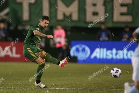 Portland Timbers defender Liam Ridgewell (24) kicks the ball during a game between Sporting KC and the Portland Timbers at Providence Park in Portland, OR. Sporting KC and the Timbers tied 0-0 in the first leg of the MLS Western Conference Finals